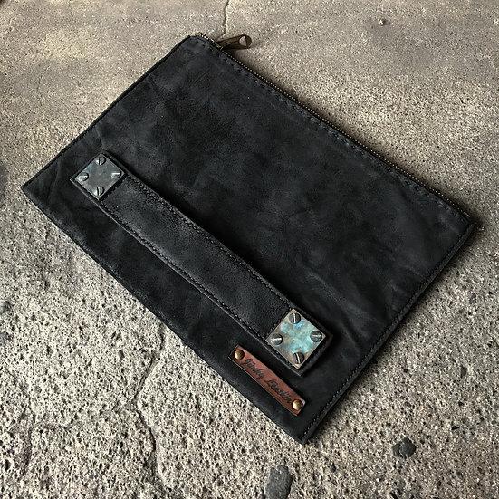 Oiled calf reverse square clutch bag