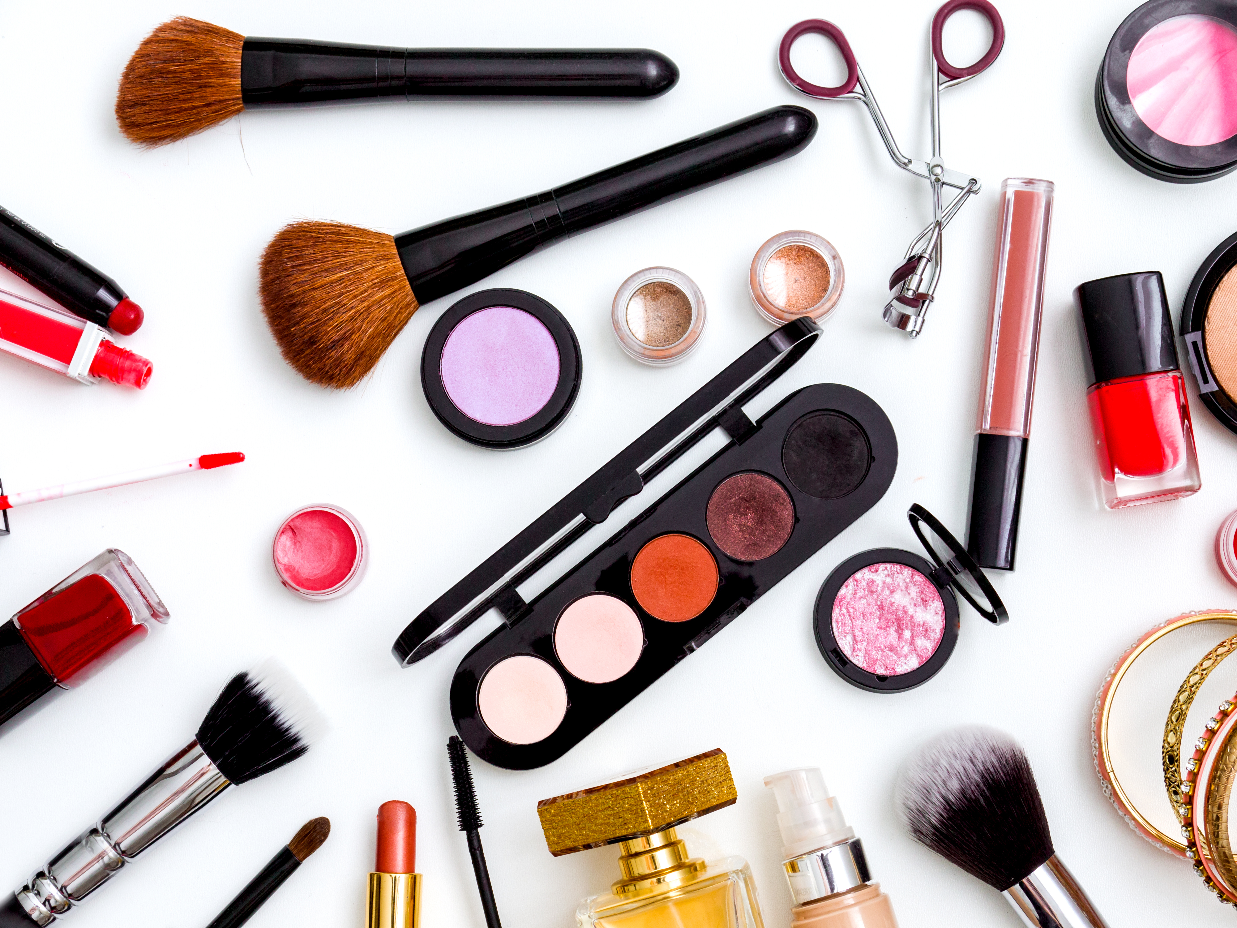 cosmetics top view on a white table. Wor
