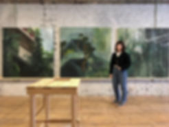 Artist in front of her paintings