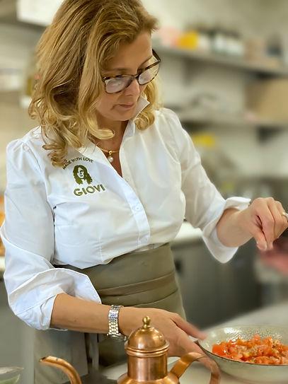 Chef lady preparing tomato in kitchen