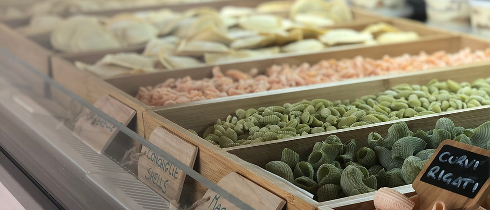 Wooden display trays of fresh pasta