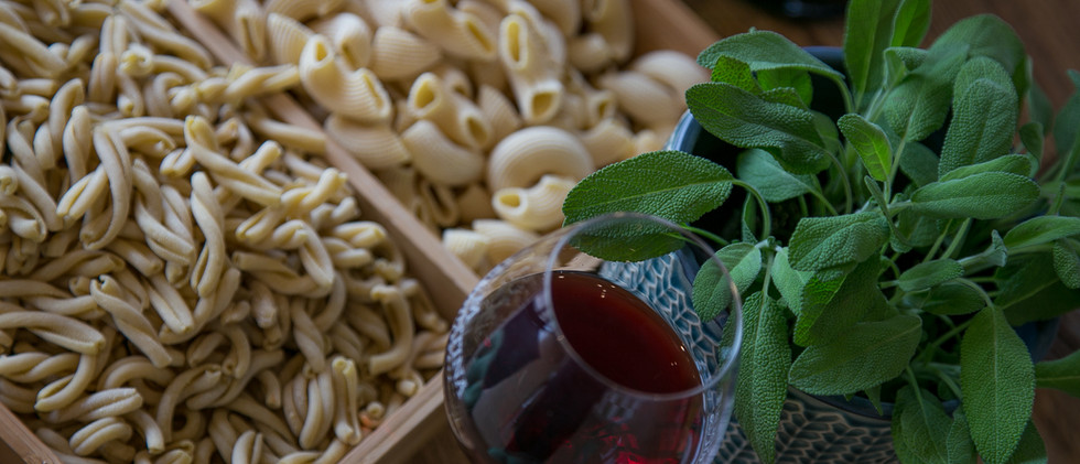 fresh pasta, red wine and sage plant