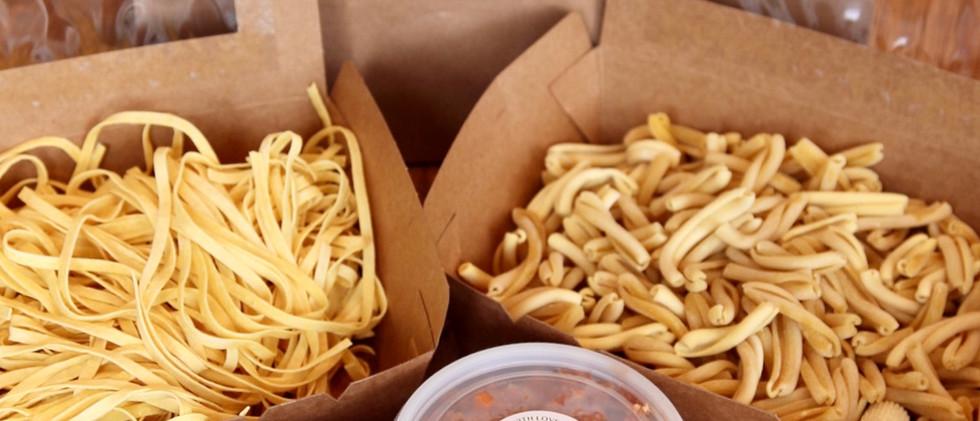 take away pasta in box amd sauce