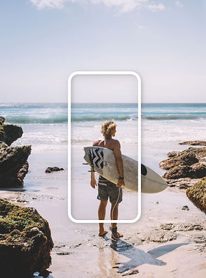 Mobile optimized website with a blonde man standing on the beach shore with a surfboard.