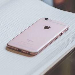 rose-gold-iphone-6s-on-white-book-near-c