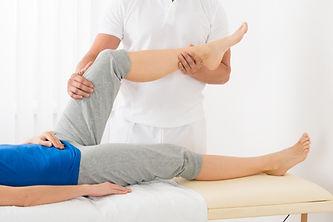Close-up Of Masseur Giving Leg Massage T