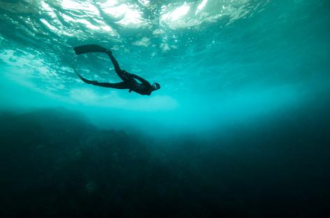 Beneath the crashing waves