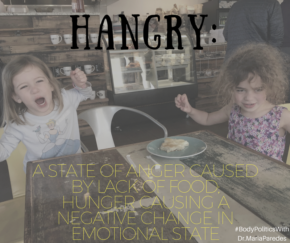 photo of 2 kids making angry faces with definition of Hangry: Stage of Anger Caused by Lack of Food