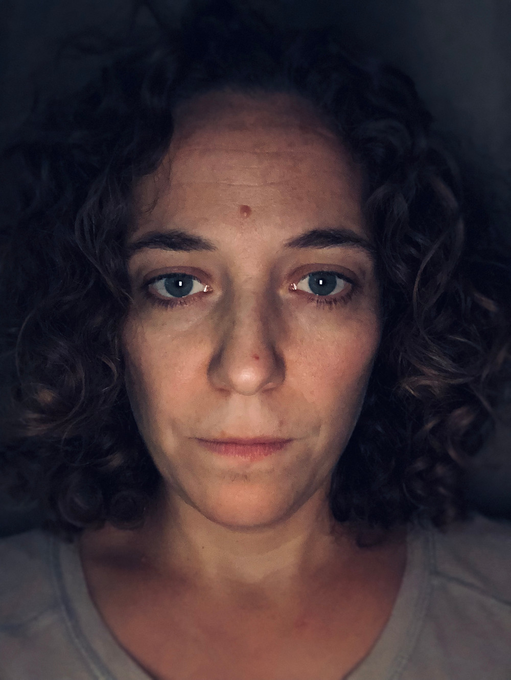 Picture of author, White woman, looking straight in camera, blank face