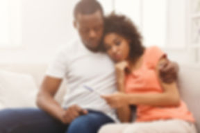 Sad african-american couple after negati