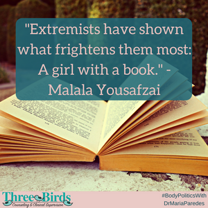 """Photo of open book with Malala quote that says """"Extremists have shown what frightens them most: A girl with a book."""