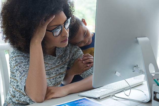 mother-with-his-son-looking-at-computer-