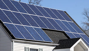 solar panels on roof of home in sunlight