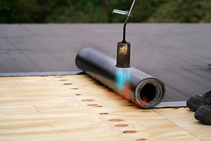 Bitumen roofing.  A with a gas burner an