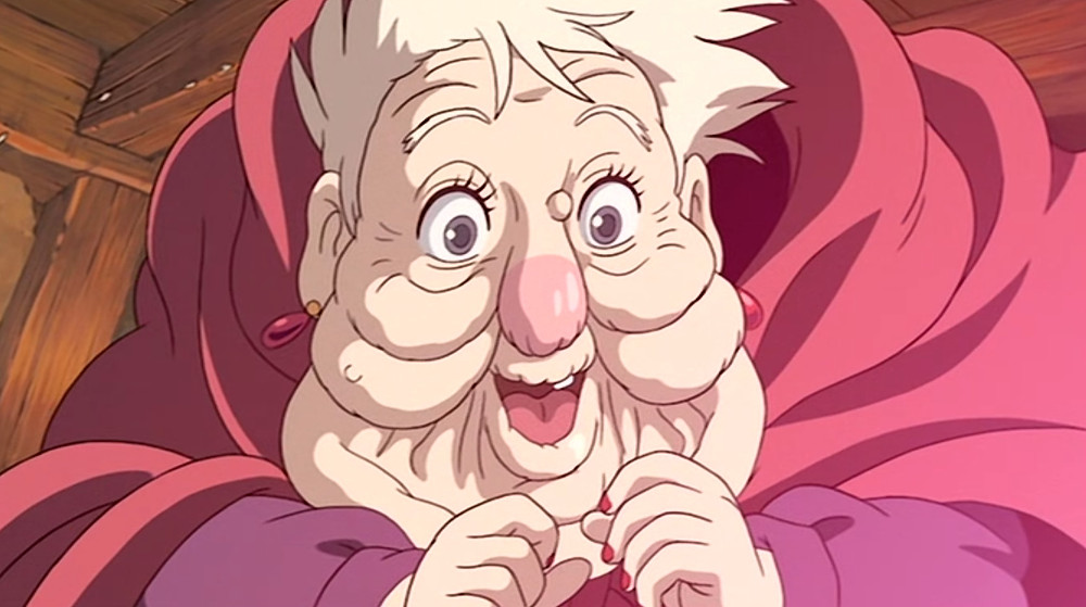 Old Witch of the Waste wearing a red shawl from the anime Howl's moving castle.