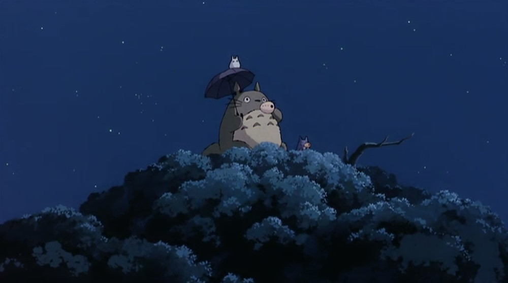 Totoro and friends on top of a tree playing the ocarina at night