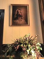 Jesus painting peering out the antique hand crafted atisan glass work the adorns our church windows.