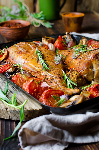 Baked sea bass with vegetables and herbs