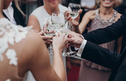 christmas luxury celebration feast. champagne and wine glasses in hands at luxury wedding