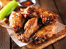 barbecue chicken wings close up on woode