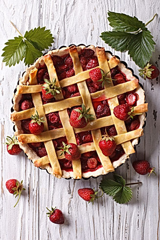 Strawberry pie with fresh berries in a b