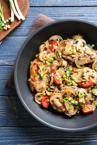 Tasty chicken marsala on pan on table.jp