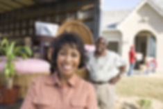 Cheerful African American couple moving