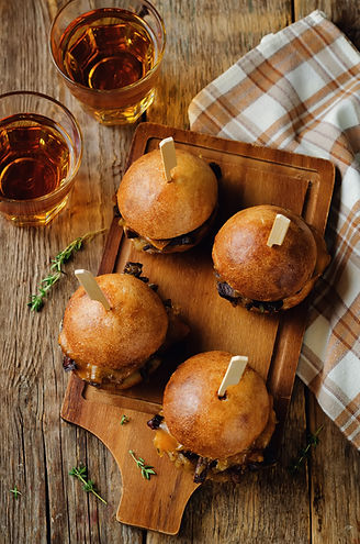 French Onion beef sliders with beer on a