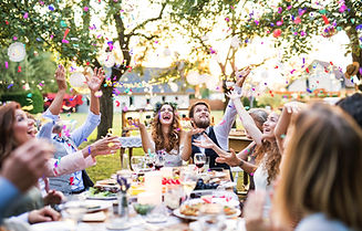 Bride and groom with guests at wedding reception outside in the backyard..jpg