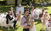 Mid adult bride and groom in garden amon