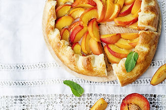Galette with peaches on a white backgrou