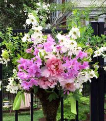 Floral arrangement hangs on garden fence during Garden Day in Lynchburg