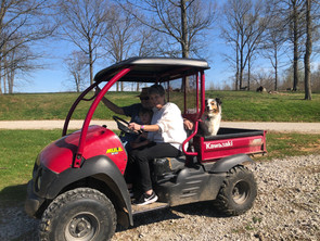 Brittney's parents helping on the farm