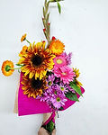 Flower arrangment bouquet with sunflowers and daisies