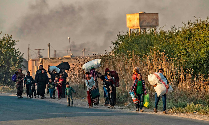 KURDS FLEE TURKISH BOMBINGS 10.10.2019.j