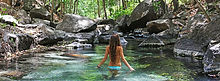Woman relaxing in the hot springs at Costa Rica volcano tours.
