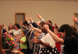 People worshipping at the altar of Monroe Apostolic Church