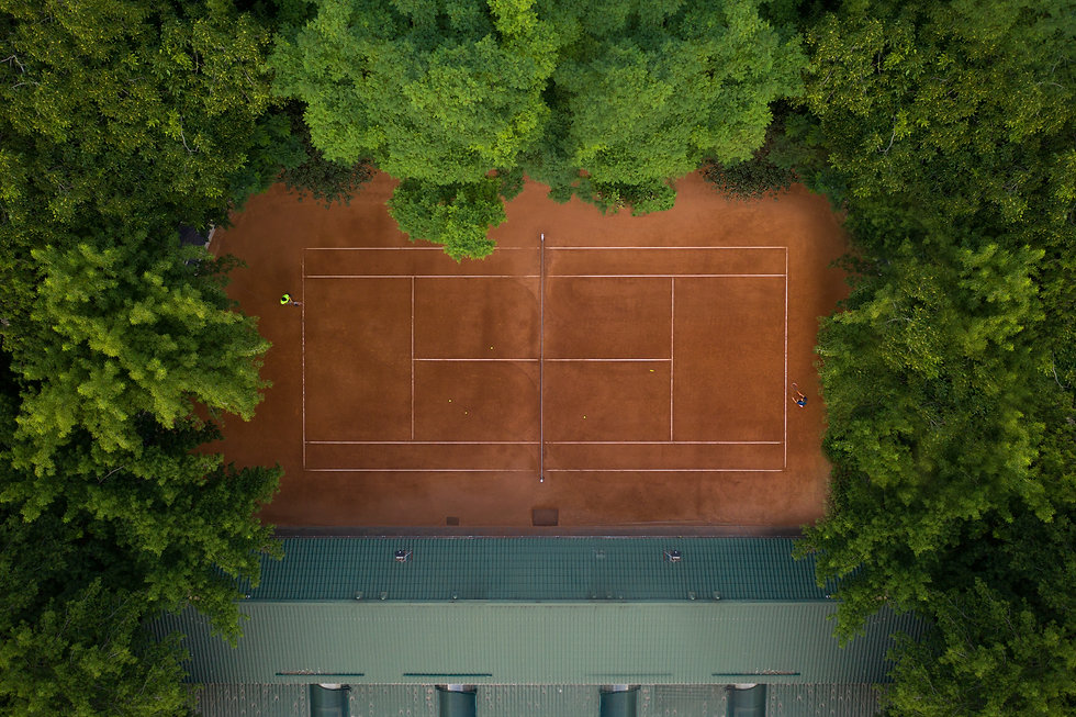 Tennis clay court with players who are t