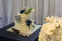 wedding cake with navy blue flowers