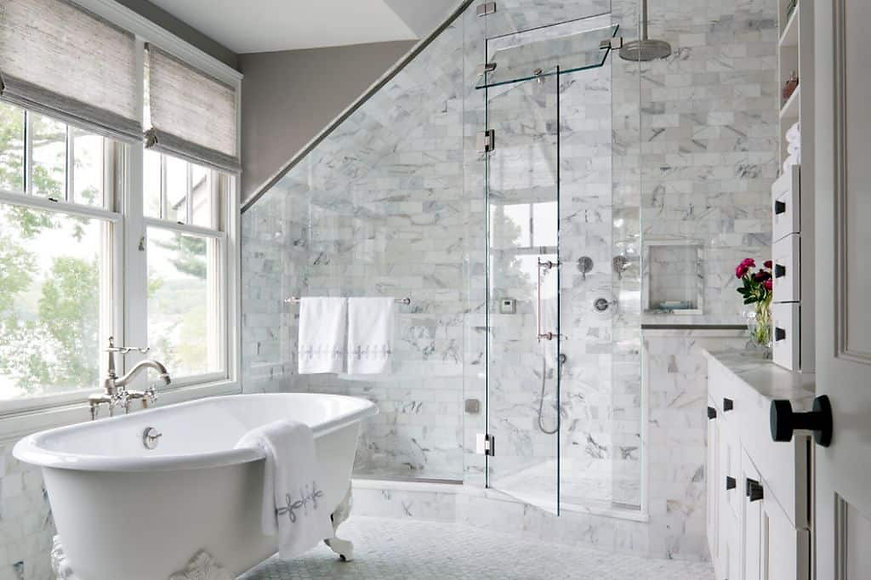 bathroom-with-clawfoot-tub-and-marble-shower-tiles.jpg