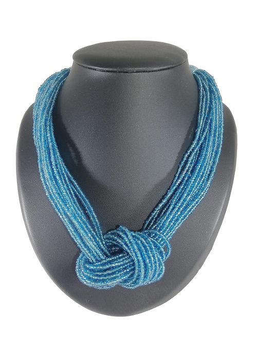 Collier de perles bleues turquoise à nœud