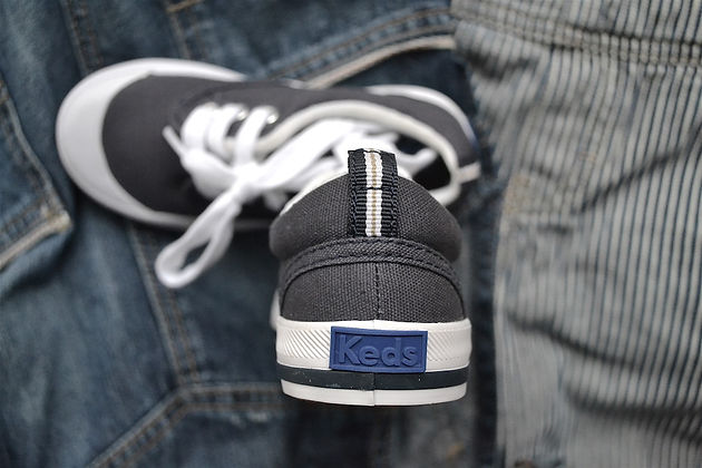 9350536a4ffe3 ... Keds logo and the 1916 box detail that inspired this post. The product  is surrounded by additional heritage pieces from my son s closet- all of  which I ...