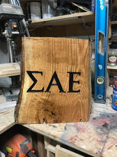 Fraternity Letters on Wooden Stump
