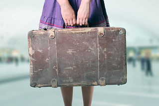 Lucy holding suitcase