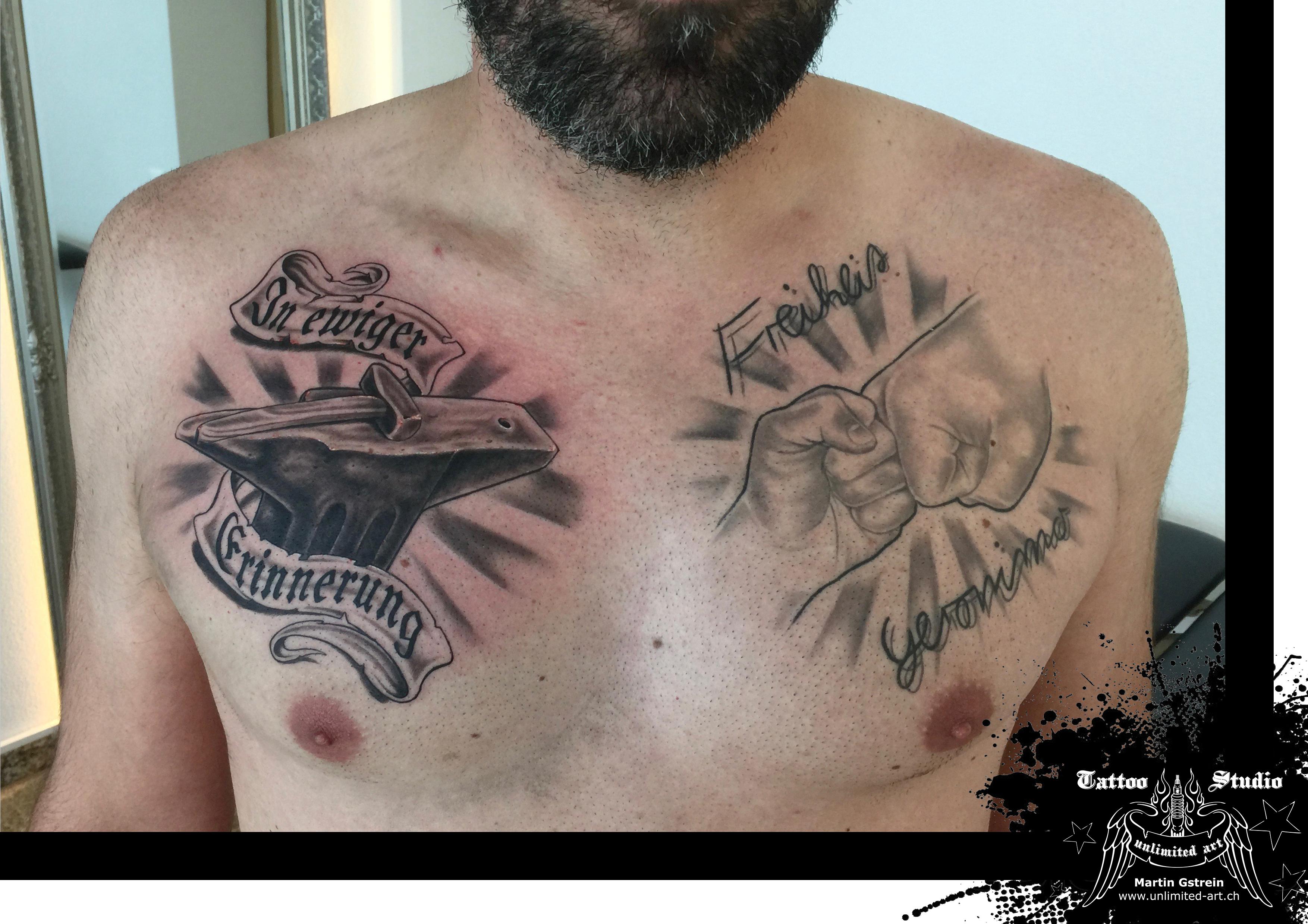 black & grey breast tattoo