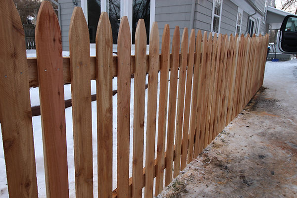 Stockade style picket fence