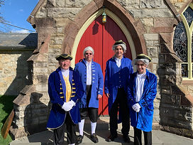Ushers dress in period costume.