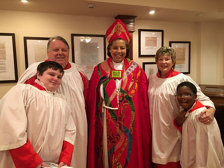 Bishop Carlye Hughes, Joe and Debbie Mello, and members of the Christ Church Junior Choir