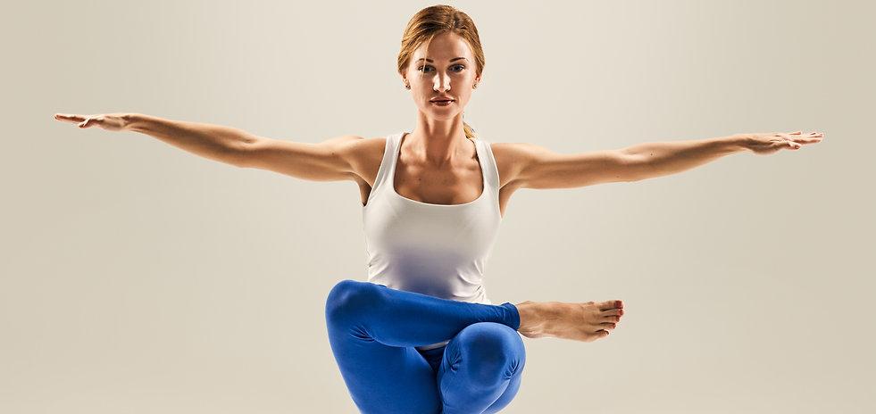 young beautiful yoga pose. balancing on