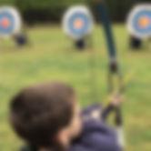 Boy Shooting Arrows